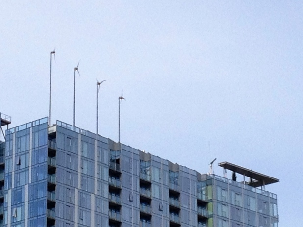 Wind turbines and solar panels on the Indigo Tower at Twelve West in Portland, Oregon
